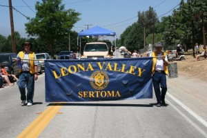 Leona Valley Parade proudly displaying banner.