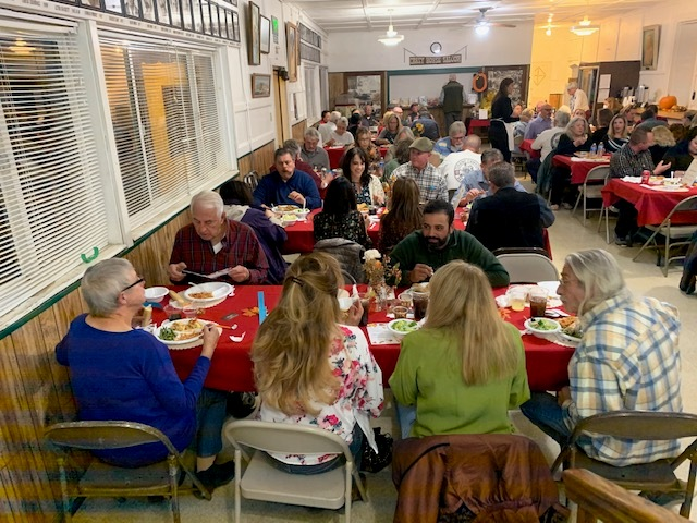 people eating dinner at the murder mystery dinner theater